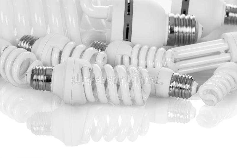 Compact, fluorescent, energy-saving light bulbs of different power, isolated on white. Background stock photo