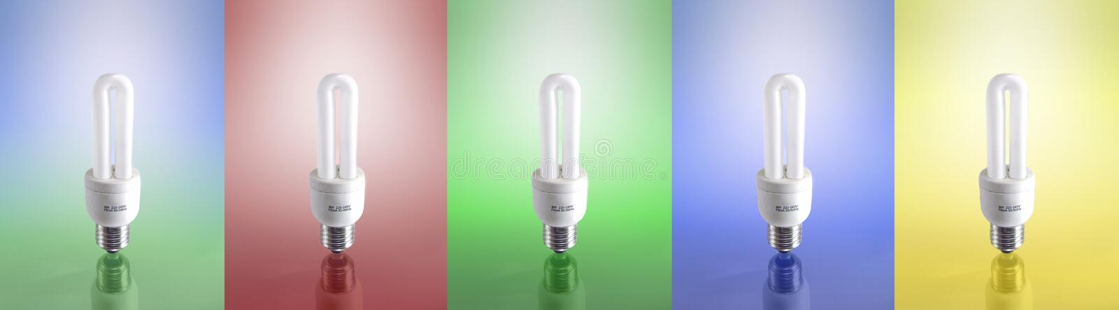 Compact Fluorescent Lamp (5 Different Versions). 5 different versions of a compact fluorescent lamp. yellow red blue green and world background. with reflextion royalty free stock photo