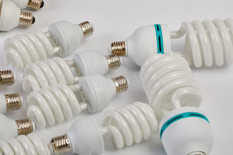 Compact Flurescent Bulbs. Many fluorescent lightbulbs in a pile stock images