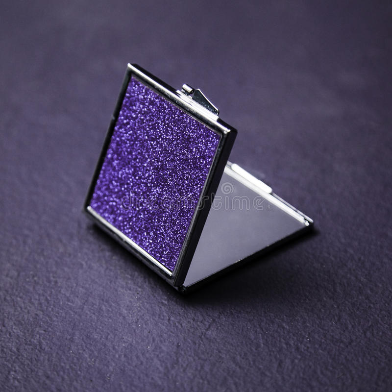 Compact Mirror. On purple background stock image