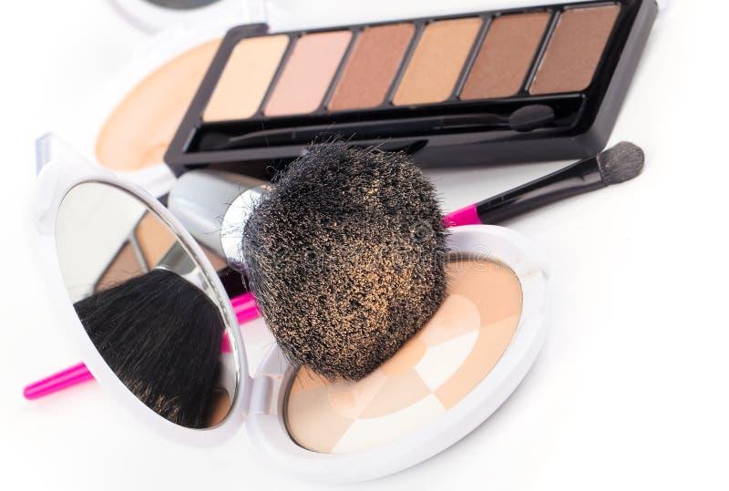 Compact powder and black brush stock image