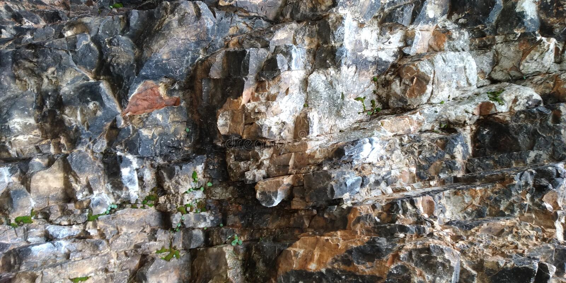 Compact Rock texture. Rocha. Cinza Musgo. Compact Rock. Grey royalty free stock photo