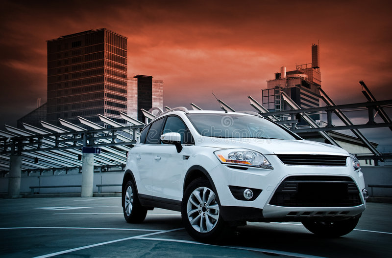 A compact SUV. A compact SUV in the city. Dramatic sky stock photography