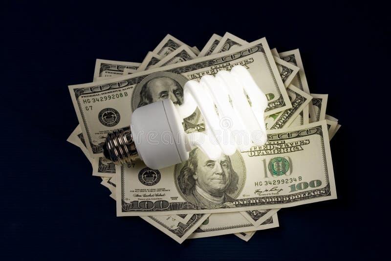 Compacte Fluorescente Lightbulb en dollar royalty-vrije stock afbeelding