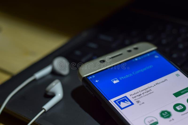 Compagno delle foto, un'applicazione dello sviluppatore di progetto del garage di Microsoft sullo schermo di Smartphone fotografie stock libere da diritti