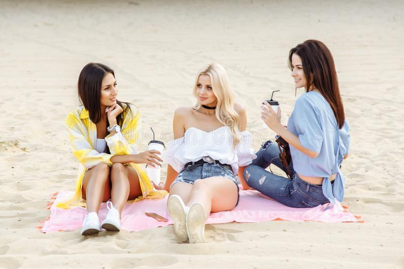 The company of beautiful young women on the beach.  royalty free stock image