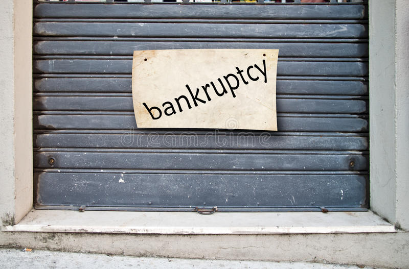 Company closed shop closed for bankruptcy. Portcullis lowered for ever of an enterprise that went bankrupt royalty free stock image