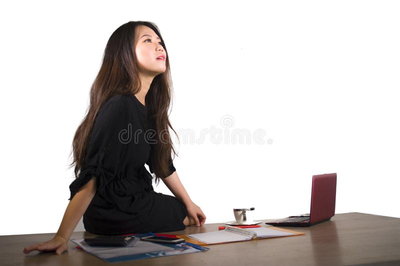 Company corporate isolated portrait of young beautiful and successful Asian Chinese business woman thinking and smiling cheerful w royalty free stock photo