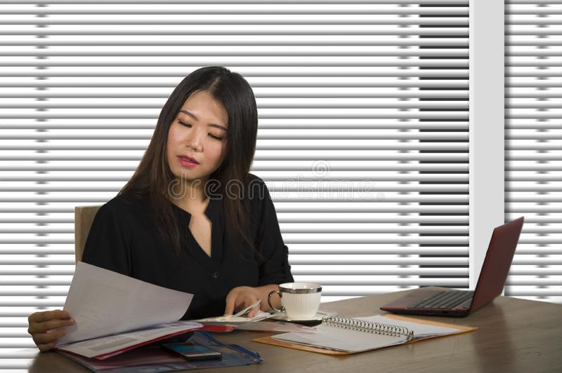 Company corporate portrait of young beautiful and busy Asian Chinese woman working busy at modern office computer desk by venetian stock images