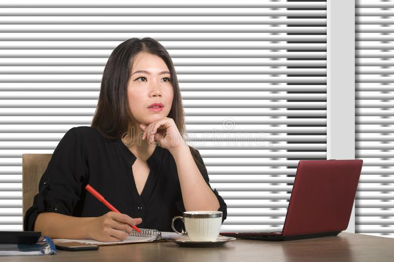 Company corporate portrait of young beautiful and busy Asian Korean woman working busy at modern office computer desk by venetian stock image