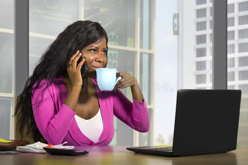 Company corporate portrait of young happy and attractive black african american businesswoman smiling confident standing at office stock images