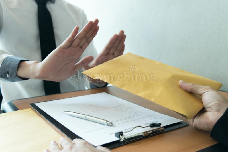 Company employees are dishonest by bringing money to the personnel department in order to be promoted to the head of production. But being affected by receiving stock photo
