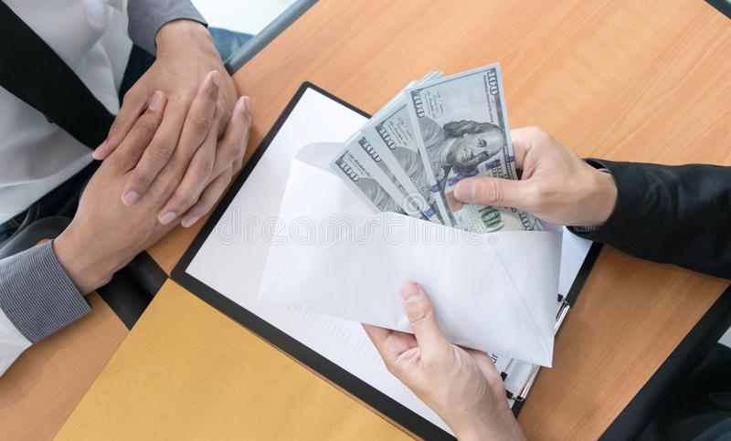 Company employees have been corrupt by bringing money to the company`s human resources department. To allow him. To be promoted to manager royalty free stock images