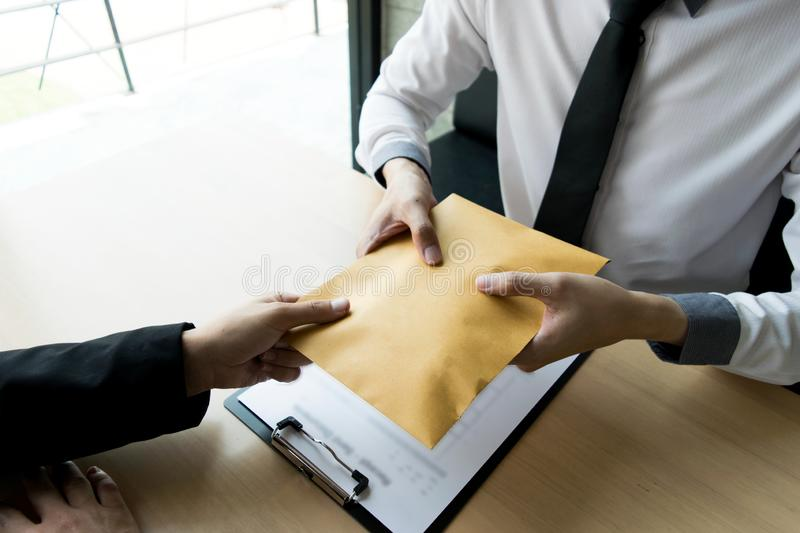 Company employees have been corrupt by bringing money to the company`s human resources department. To allow him. To be promoted to manager stock image