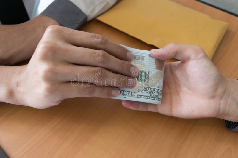 Company employees have been corrupt by bringing money to the company`s human resources department. To allow him. To be promoted to manager stock photo