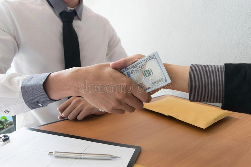 Company employees have been corrupt by bringing money to the company`s human resources department. To allow him. To be promoted to manager stock images