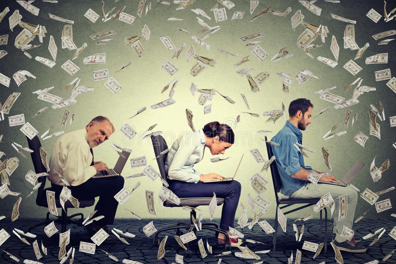 Company employees working on laptops making money under dollar banknotes rain. Successful internet business concept stock photos
