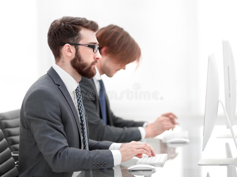 Company employees working in software development. And designer office stock photo