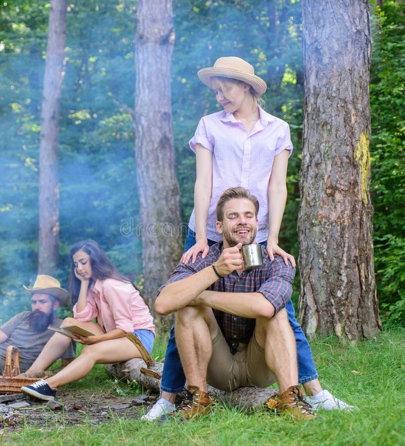 Company friends couples or families enjoy relaxing together forest. Find companion to travel and hike. Awesome hiking. Great company. Friends relaxing near stock image