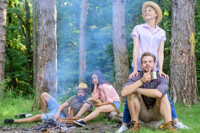 Company friends couples or families enjoy relaxing together forest. Find companion to travel and hike. Friends relaxing. Near campfire after day hiking nature stock image