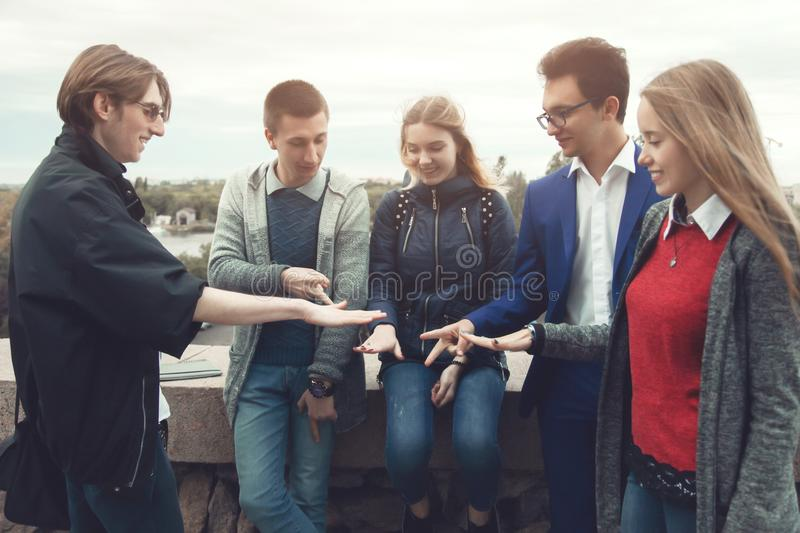A company of friends plays a game stock photo
