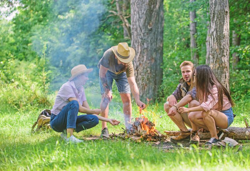 Company friends prepare roasted marshmallows snack nature background. Camping activity. Company youth camping forest stock photography
