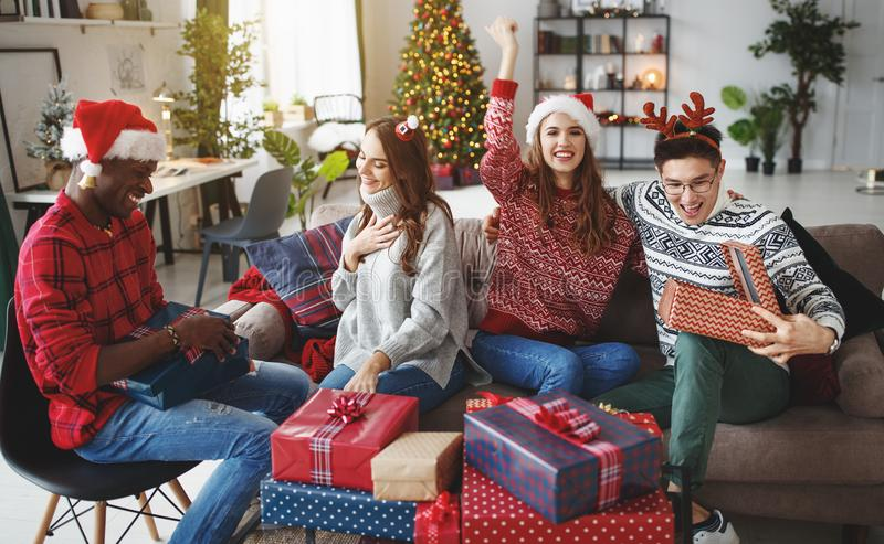 company of happy friends celebrating Christmas and New Year stock photo