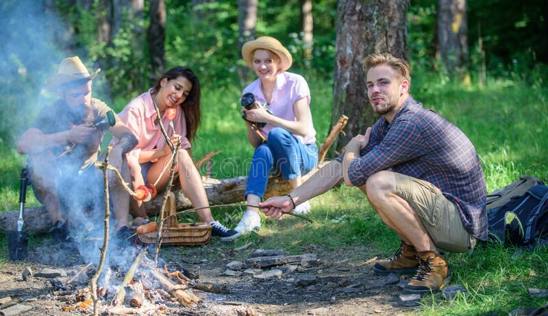 Company having hike picnic nature background. Hikers sharing impression of walk and eating. Summer hike. Picnic with stock photo