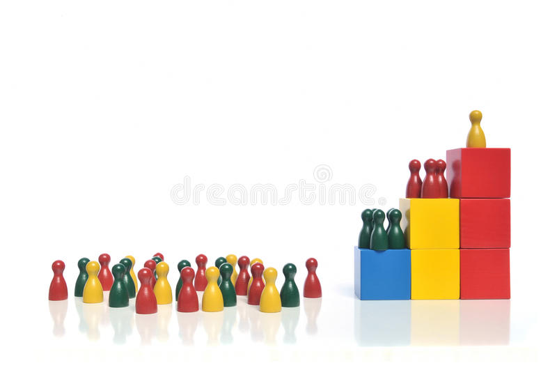 Company hierarchy. Hierarchy - Multicolored wooden toy blocks and figures on white background royalty free stock images