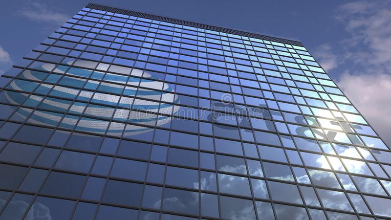 Logo of ATT on a media facade with reflecting cloudy sky, editorial 3D rendering. Company logo on modern building against sky background, conceptual editorial 3D royalty free stock photo