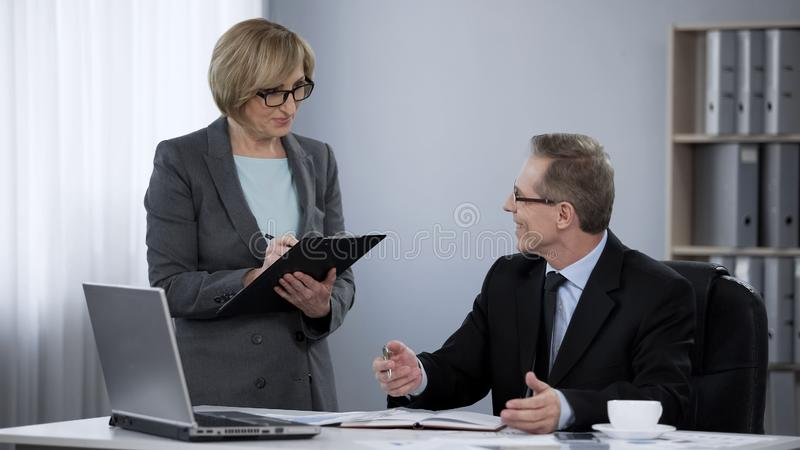 Company partners approving business plan, mutual respect, teamwork cooperation stock images