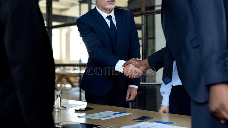 Company partners shaking hands, diplomat delegation greeting, cooperation. Stock photo stock photography