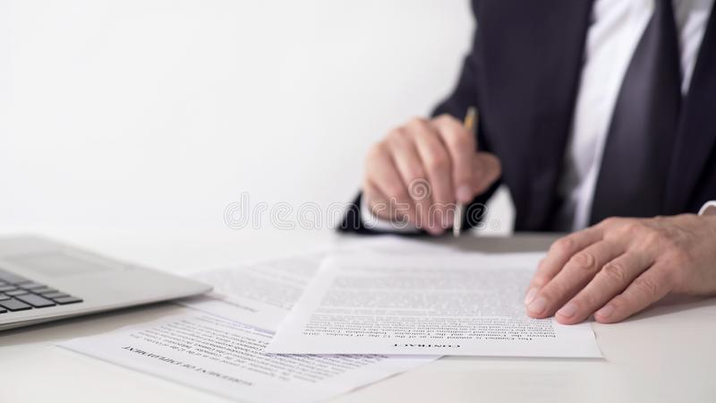 Company president reading contract, signing important cooperation agreement stock photos