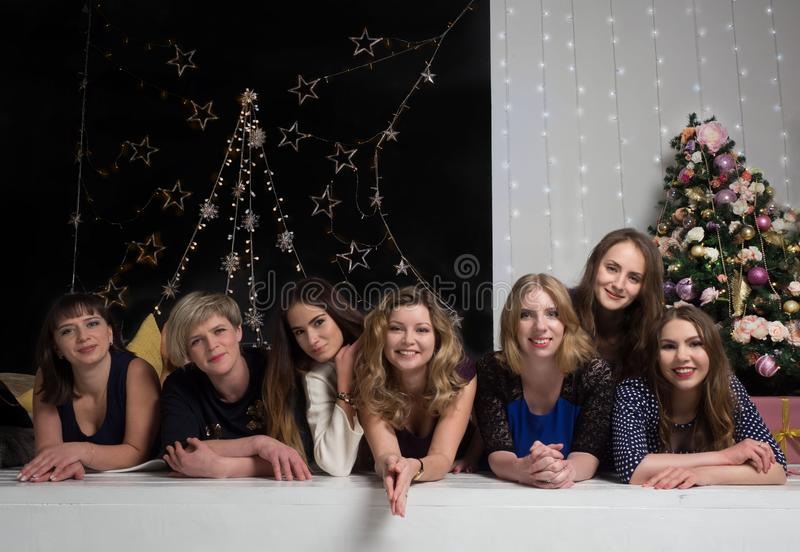 The company of pretty girls meets the new year. royalty free stock photo