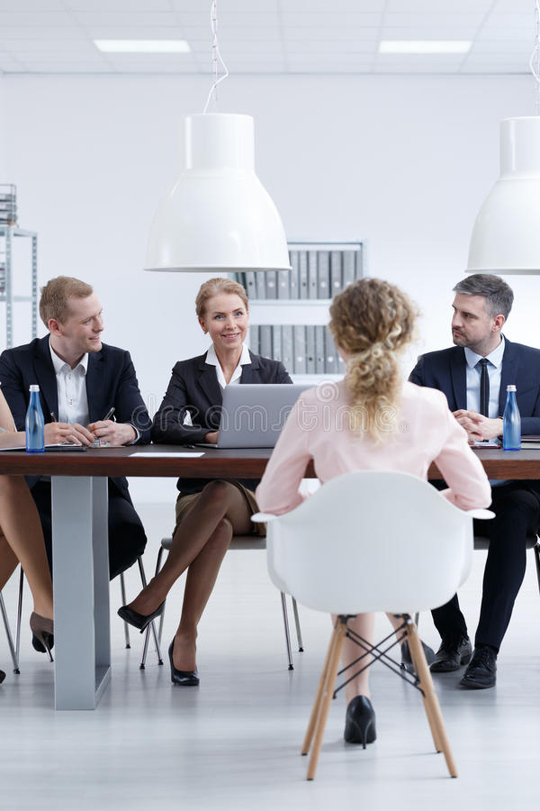 Company recruitment committee. Sitting in front of company recruitment committee stock images