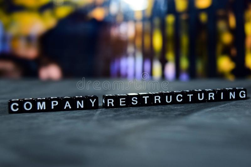 Company restructuring on wooden blocks. Business and finance concept. Cross processed image with bokeh background stock photography