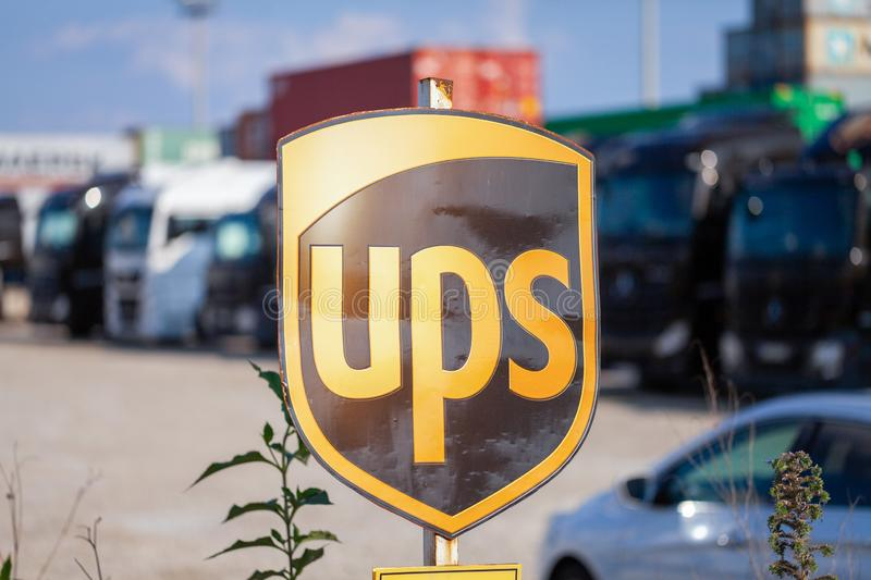Company sign from the American multinational package delivery, United Parcel Service UPS. NUREMBERG / GERMANY - AUGUST 4, 2019: Company sign from the American stock photo