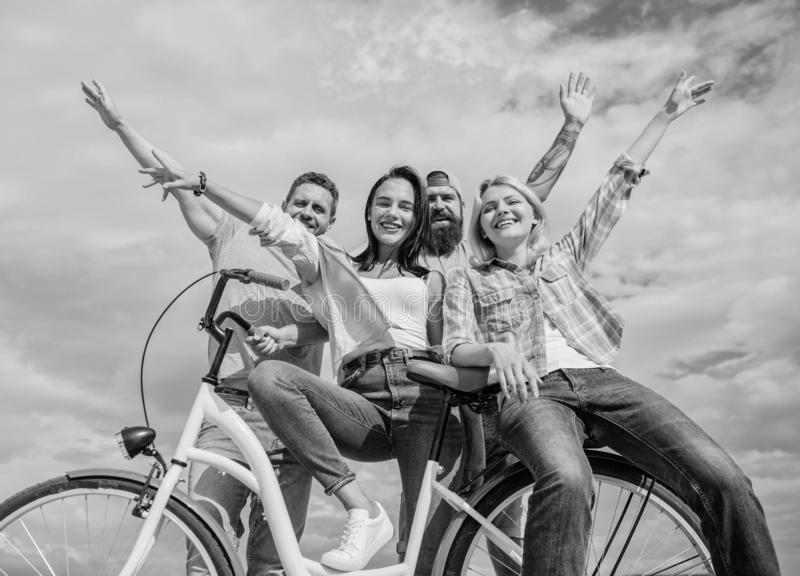 Company stylish young people spend leisure outdoors sky background. Bicycle as part of life. Cycling modernity and. National culture. Group friends hang out royalty free stock images