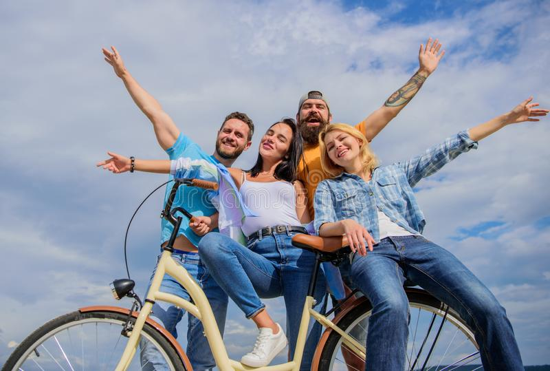 Company stylish young people spend leisure outdoors sky background. Cycling modernity and national culture. Bicycle as. Part of life. Group friends hang out royalty free stock photos
