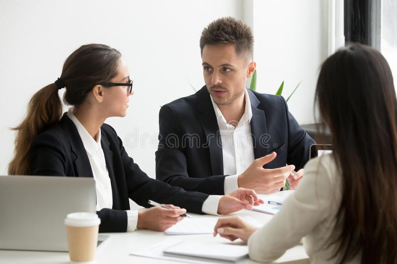Colleagues discussing business strategy in office. Company workers, colleagues talking discussing corporate business strategy, financial reports and statistics stock photo