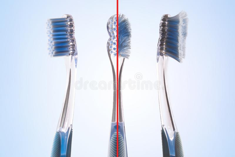 Comparación entre el nuevo y usado concepto del cepillo de dientes fotos de archivo