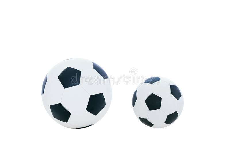 Comparative big and small football. Isolated on white background. Comparative big and small football. Comparison concept. Isolated on white background stock images