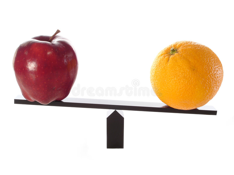 Comparing Apples to Oranges. On a balance beam royalty free stock photo