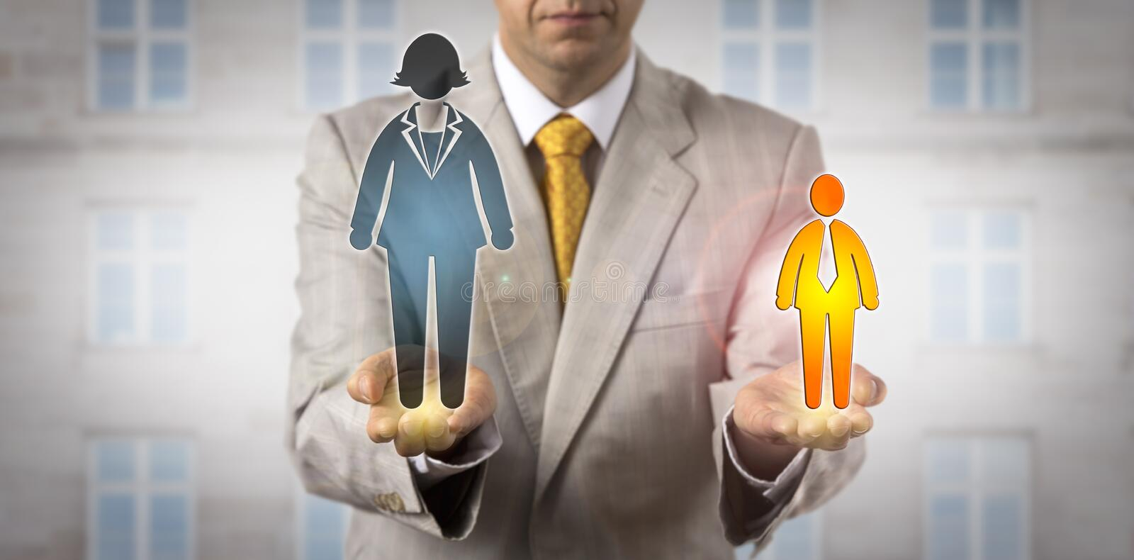 Comparing Small Man With Huge Female Worker stock photo