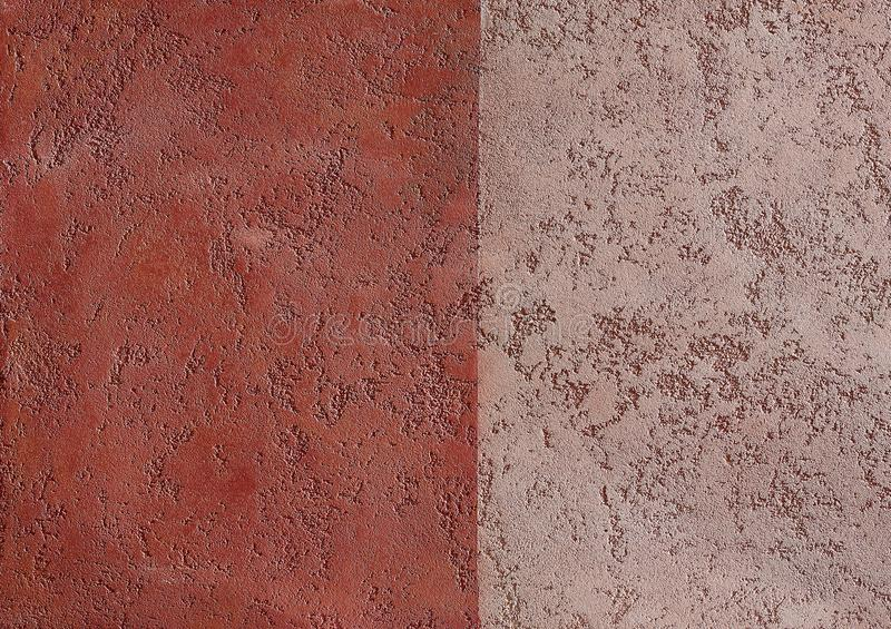 Comparing two types of herry plaster textured background. Abstact brown stucco. Texture of plaster on the wall. Comparing two different types of cherry plaster royalty free stock image