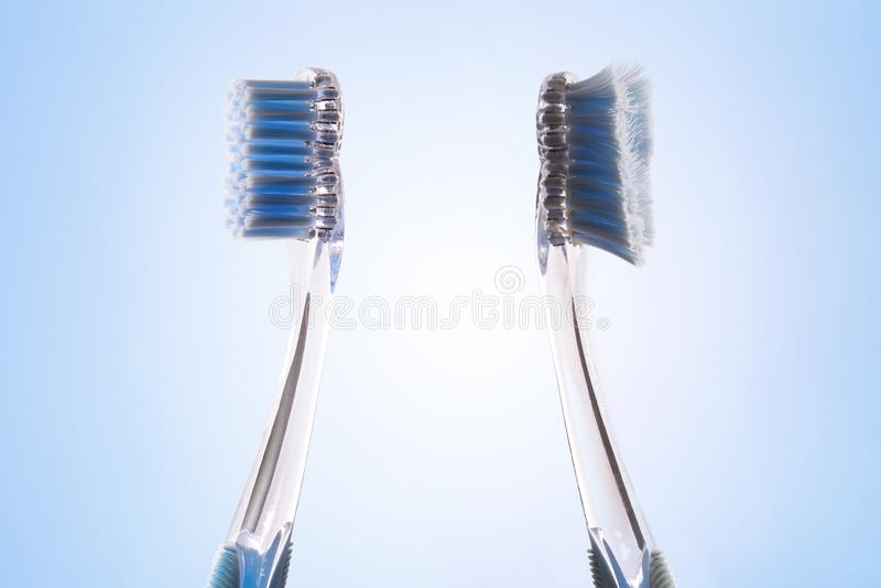 Comparison between new and used tooth brush backwards stock photos