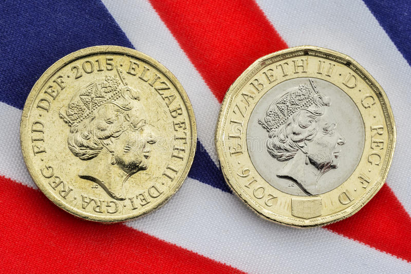 Comparison of old and new British pound coins. Heads. Comparison of old and new heads side of British pound coin on a Union Jack flag background. The new coin stock photo