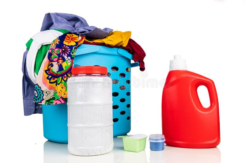 Comparison of powder and liquid laundry detergent with laundry basket  full of apparel stock image