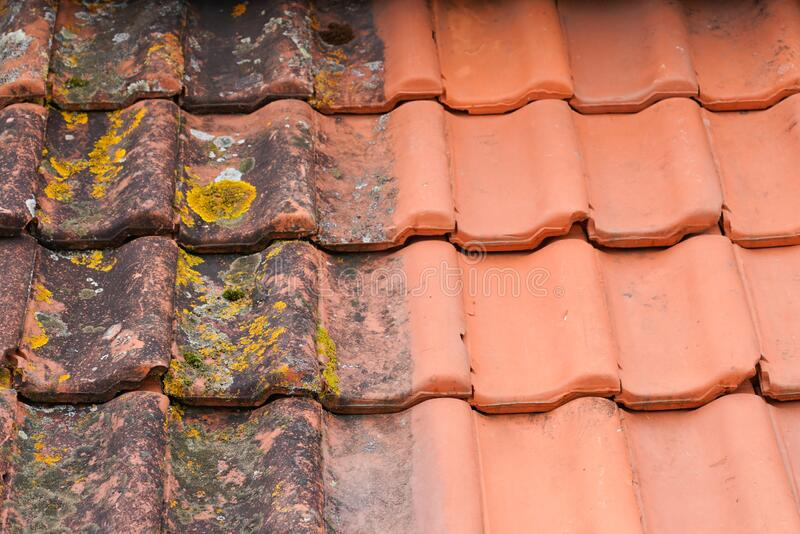 Comparison roof top before and after cleaning moss lichen high pressure water cleaner tile. A Comparison roof top before and after cleaning moss lichen high royalty free stock photos