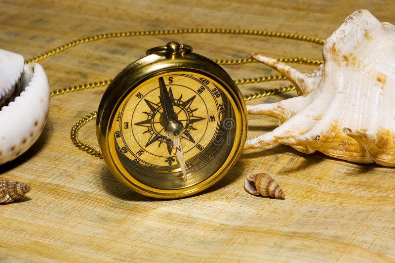 Compas d'or de vieux type photos stock